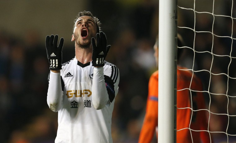 Swansea City's Spanish striker Alvaro Vazquez reacts to missing a late chance on goal during the Group A Europa League football match between Swansea and Valencia CF at The Liberty Stadium in Swansea on November 28, 2013. Valencia won the game 1-0. (Adrian Dennis/AFP/Getty Images)