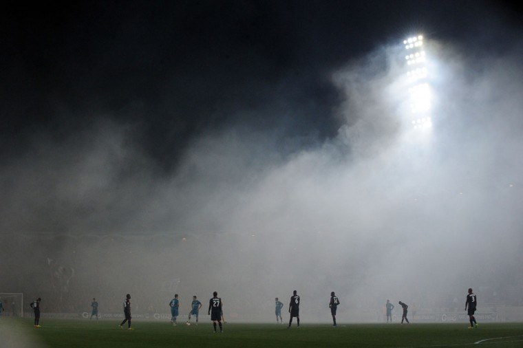 Bordeaux's and Frankfurt's players are seen standing on the pitch at the beginning the UEFA Europa League Group F qualifying football match between FC Girondins de Bordeaux and Eintracht Frankfurt on November 28, 2013 at the Chaban-Delmas Stadium in Bordeaux, western France. (Nicholas Tucat/AFP/Getty Images)