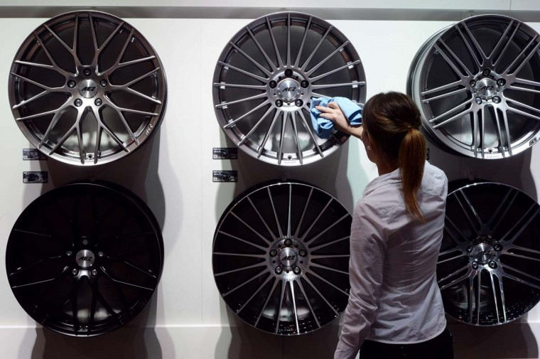 A woman polishes rims at the Essen Motor Show on November 29, 2013 at the fair grounds in Essen, western Germany. The motor show presents motorcycles, cars and tuning parts from around 600 exhibiting companies from different countries. Essen Motor Show takes place from November 30 until December 8, 2013. PATRIK STOLLARZ/AFP/Getty Images ORG XMIT: 84