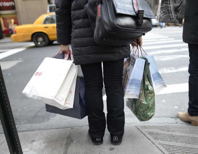 Shoppers take advantage of sales on 5th Avenue November 29, 2013, during the Black Friday shopping day. The holiday shopping season kicked off earlier this year, as dozened of stores opened on Thanksgiving Day November 28, 2013. (Timothy Clary/AFP/Getty Images)