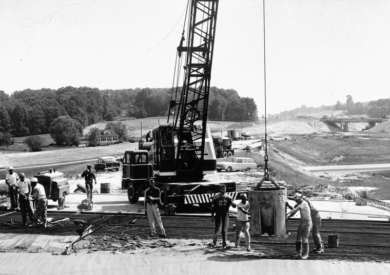 Construction workers pour cement while building I-95 in 1962. (Baltimore Sun)