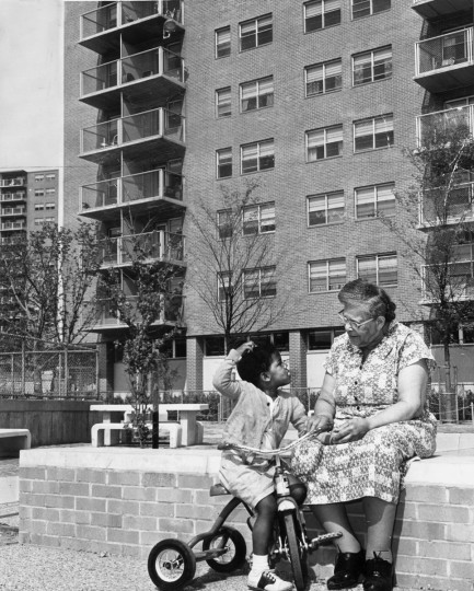 05/21/1964 - Baltimore, MD - Mrs. Rosa Bulter talks with Lynette House, 3, in front of George B. Murphy Homes, Baltimore's first public housing with apartments designed especially for elderly. (Weyman Swagger/Baltimore Sun)