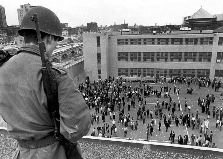 4/11/1968 - Baltimore, MD - A National Guardsman stands atop the City Jail, where many of the people arrested during the 1968 riots have been incarcerated prior to their trial or release. (Weyman Swagger/Baltimore Sun)