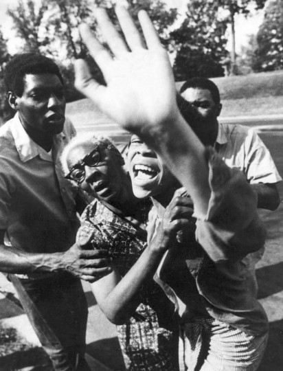 7/18/1971 - Baltimore, MD - A grief stricken women is restrained by her mother and two men after she saw her house on fire and feared her children were still inside. (Weyman Swagger/Baltimore Sun)