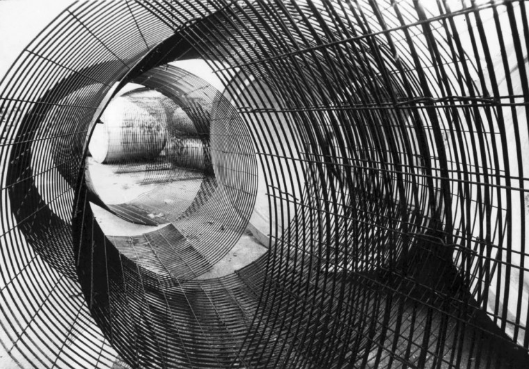 12/17/1979 - Baltimore, MD - A geometric pattern is formed by rolls of reinforcing wire waiting in the yard of Gray Concrete Pipe Co. in East Baltimore where they are coated with concrete and used for sewers. (Weyman Swagger/Baltimore Sun)