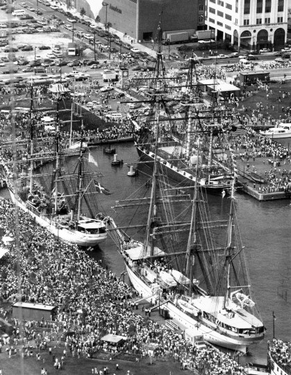 7/11/1976 - Baltimore, MD - Police estimated 100,000 people crowded the Inner Harbor and thousands more lined the Outer Harbor to see the Danmark (left), the Gorch Fock (right) and other tall ships as part of Operation Sail. Baltimore's frigate Constellation is at the upper right. (Weyman Swagger/Baltimore Sun)