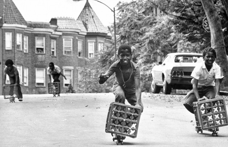 "8/4/1973 - Baltimore, MD - These children found a hill in the 700 block of Newington Avenue that was just right for giving skate boxes a good workout. The old proposition that ""what goes up must come down"" is hard to reverse, these youngsters learned. But, trudging up the hill, dragging your skate box behind, is the price of feeling the wind in your face as you race back down. (Weyman Swagger/Baltimore Sun)"