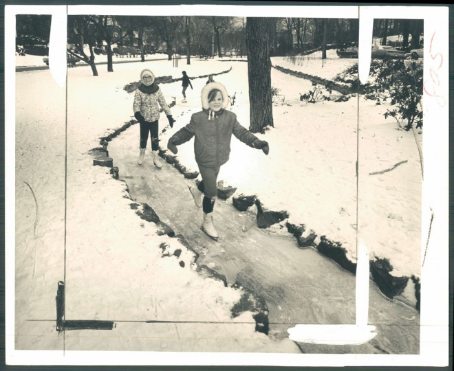 A frozen causeway connects two ponds at Homeland's covered stream on Springlake Way. Baltimore Sun Photo by Richard Stacks, Feb. 4, 1968.