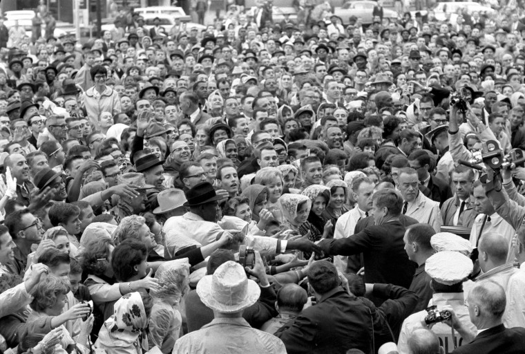 President John F. Kennedy reaches out to the crowd gathered at the Hotel Texas Parking Lot Rally in Fort Worth, Texas, on Nov. 22, 1963. The President, first lady Jacqueline Kennedy stared the day by attending a Fort Worth Chamber of Commerce breakfast at the hotel, before heading to Dallas. (Cecil Stoughton/John F. Kennedy Presidential Library and Museum/MCT)
