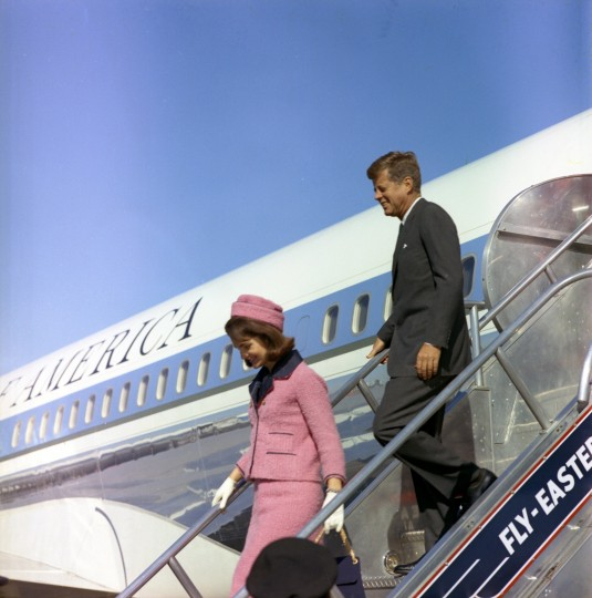 President John F. Kennedy and first lady Jacqueline Kennedy descend the stairs from Air Force One at Love Field in Dallas, Texas. (Cecil Stoughton/John F. Kennedy Presidential Library and Museum/MCT)