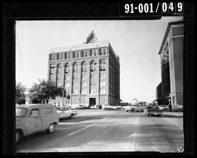 The Texas School Book Depository building, which overlooks Dealey Plaza, quickly becomes the focus of law enforcement, as the police begin the manhunt for President Kennedy's assassin. (Dallas Police Department/Dallas Municipal Archives/MCT)