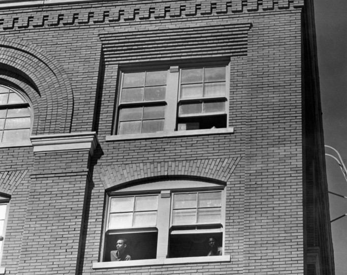 Men peer out the fifth floor window of the Depository building shortly after the assassination the president. But it is the floor above where an eyewitness reported seeing a man with a gun at the window, before the shots were fired. (Tom Dillard/Dallas Morning News/MCT)