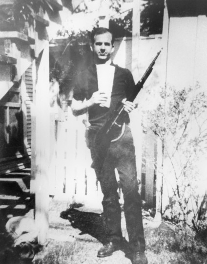 A worker at the Book Depository, Lee Harvey Oswald, 24, disappears from the building immediately after the shooting, and boards a bus. When the bus gets caught in traffic, he exits, and begins to walk. Oswald soon emerges as a suspect. This photograph of Oswald holding a rifle in the backyard at 214 Neeley Street in Dallas, was among the evidence gathered by the police following the assassination. (Dallas Police Department via Dallas Morning News/MCT)