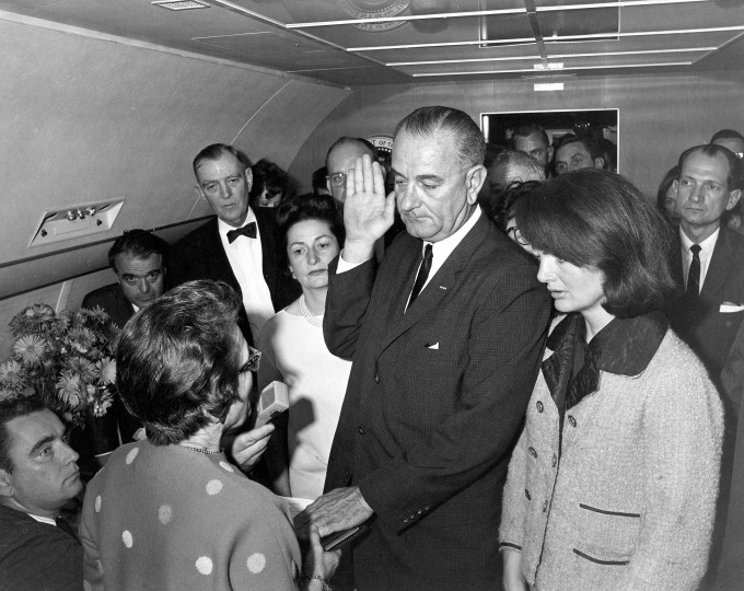 Judge Sarah T. Hughes administers the Presidential Oath of Office to Lyndon Baines Johnson at 2:39 p.m. (CST) aboard Air Force One at Love Field, Dallas Texas, on Nov. 22. Mrs. Johnson, Mrs. Kennedy, Jack Valenti, Rep. Albert Thomas, Rep. Jack Brooks, Associate Press Secretary Malcolm Kilduff (holding microphone) and others witness the oath. (Cecil Stoughton/John F. Kennedy Library and Museum/MCT)