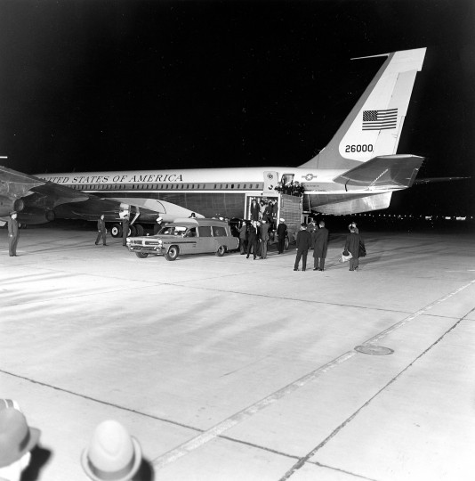 The casket bearing President Kennedy is taken from Air Force One is placed in a waiting ambulance for transport from Andrews Air Force base, Md., to the Bethesda Naval Hospital for an autopsy. (John F. Kennedy Presidential Library and Museum/MCT)