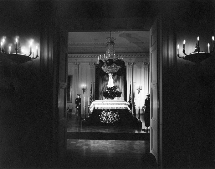 President Kennedy's casket lies in state in the East Room of the White House, attended by two members of the honor guard. (Abbie Rowe/National Park Service/John F. Kennedy Presidential Library and Museum/MCT)