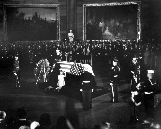 Jacqueline Kennedy and daughter, Caroline, kneel at the casket of President Kennedy, as it lies in state in the Rotunda of the U.S. Capitol in Washington, D.C., on Nov. 24. (Abbie Rowe/National Park Service/John F. Kennedy Presidential Library and Museum/MCT)