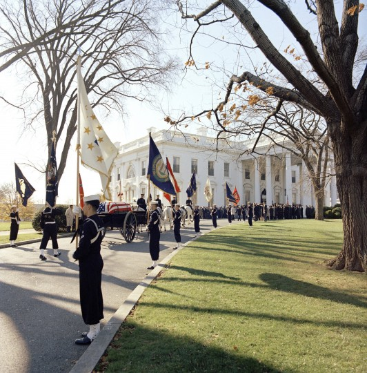 The caisson bearing the casket of President Kennedy enters the White House grounds after returning from the U.S. Capitol on Nov. 25. (Cecil Stoughton/John F. Kennedy Presidential Library and Museum/MCT)