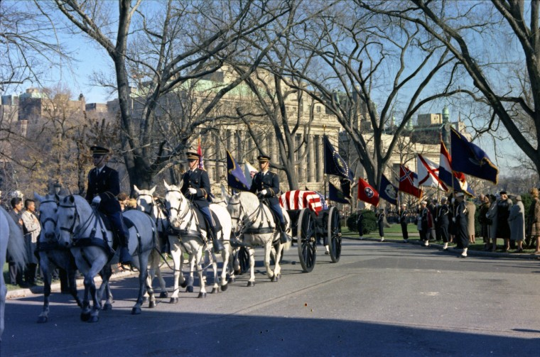 The funeral caisson carrying President Kennedy's casket enters the White House driveway on Nov. 25. (Robert Knudsen/John F. Kennedy Presidential Library and Museum/MCT)
