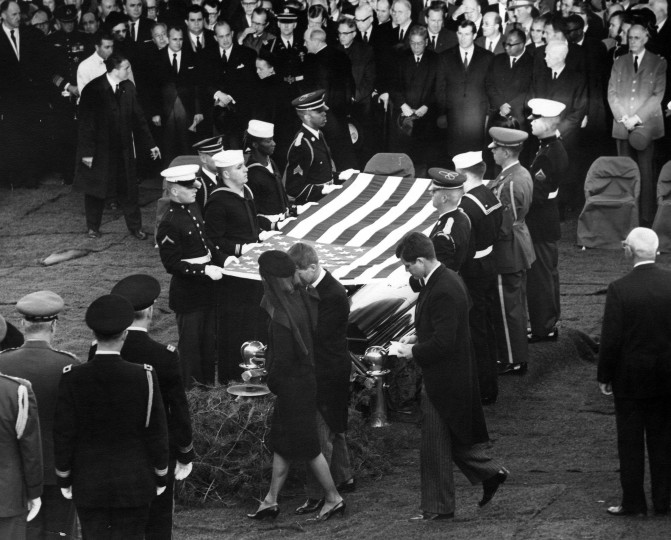Attorney General Robert F. Kennedy escorts Jacqueline Kennedy past the Honor Guard at the grave of President Kennedy, during the burial ceremony for the president at Arlington National Cemetery in Arlington, Va., on Nov. 25. Sen. Edward M. Kennedy follows behind. (Abbie Rowe/National Parks Service/John F. Kennedy Presidential Library and Museum/MCT)