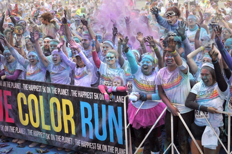 Runners party at the stage after the morning Color Run. (Amy Davis / The Baltimore Sun)