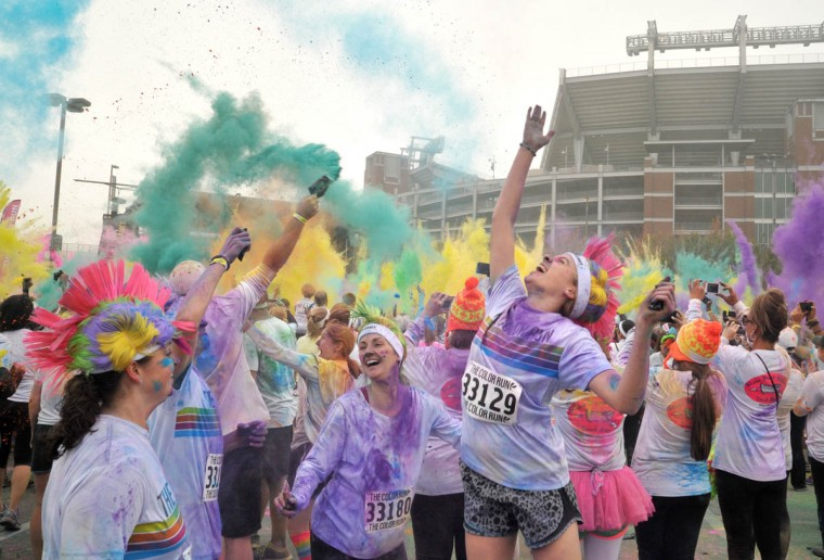 "Devan Conrad (#33129) of Baltimore celebrated her 13th birthday with her cousins after the morning Color Run. About 10,000 people participated in each of two 5k Color Runs today, in which they were doused with colored powders along the route. BIlled as the ""Happiest 5k on the Planet,"" The Color Run is operated by a for-profit management company, with partnerships with local charities. (Amy Davis / The Baltimore Sun)"