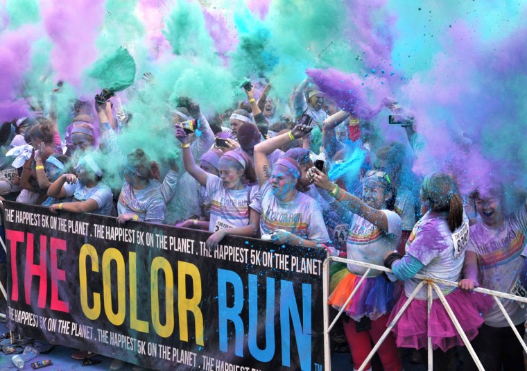 The celebration after the morning Color Run includes more color explosions. (Amy Davis / The Baltimore Sun)