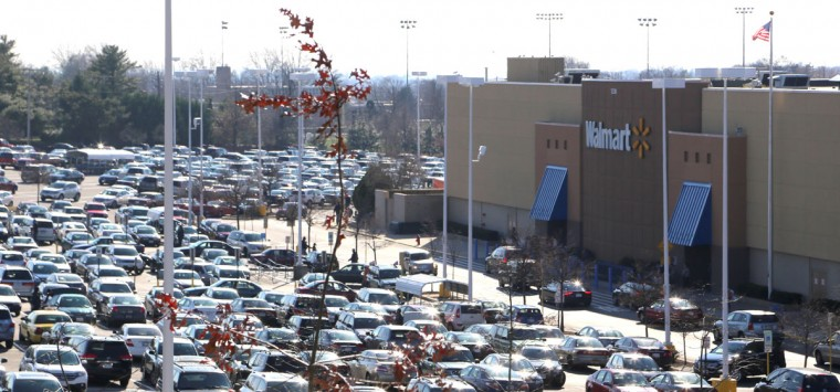 Protesters gathered outside the Towson Walmart on Joppa Road this Black Friday, one of the biggest shopping days of the year, to demand higher wages and equality from the world's biggest chain. (Kaitlin Newman/Baltimore Sun)