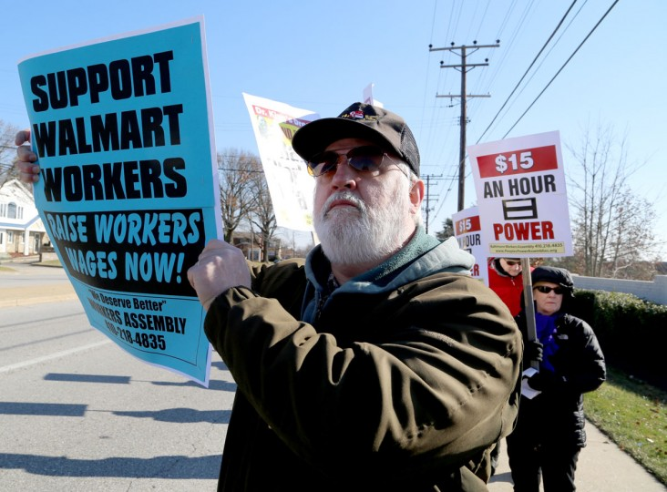 Russell Jenkins, 58, holds a sign in protest outside the Towson Walmart on Joppa Road this Black Friday. Protestors gathered on one of the biggest shopping days of the year to demand higher wages and equality from the world's biggest chain. (Kaitlin Newman/Baltimore Sun)
