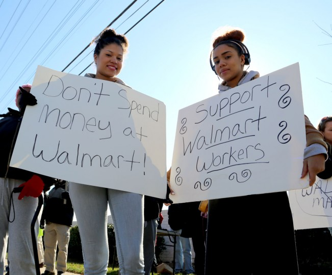 Alex Jones, 17, left and Sam Jones, 14, right hold signs in protest outside the Towson Walmart on Joppa Road this Black Friday, one of the biggest shopping days of the year, to demand higher wages and equality from the world's biggest chain. Both came from Wilmington, DE to show their support. (Kaitlin Newman/Baltimore Sun)