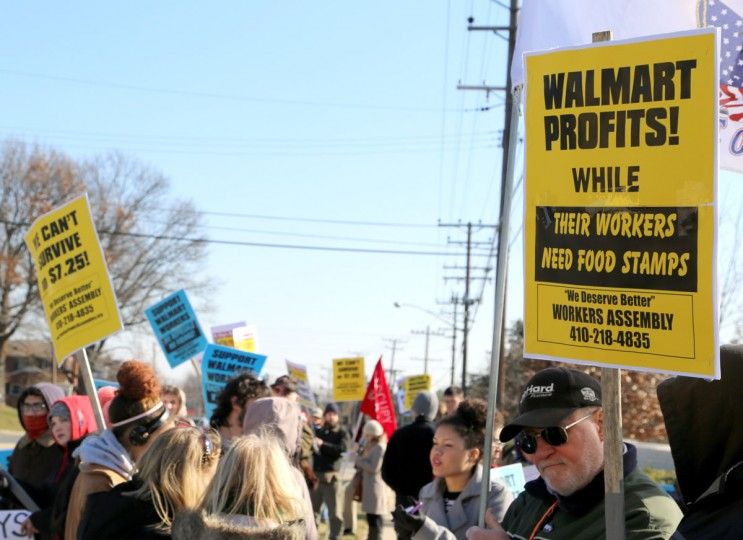 People gathered in protest outside the Towson Walmart on Joppa Road this Black Friday, one of the biggest shopping days of the year, to demand higher wages and equality from the world's biggest chain. (Kaitlin Newman/Baltimore Sun)