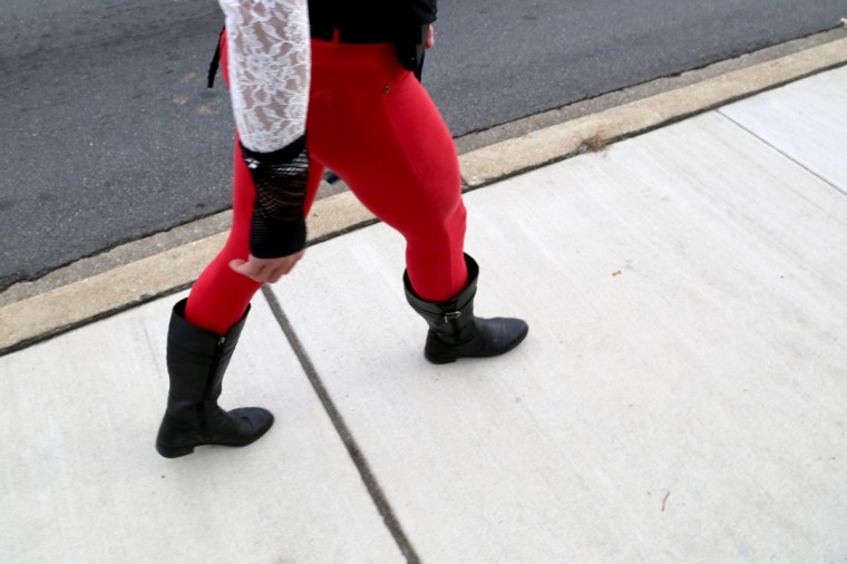"Dale Crites, known as BritneyGirl Dale to locals, walks along Ritchie Highway, waving to drivers and other pedestrians. Crites also walks around the Inner Harbor as well. ""They love me down there, honey!"" he says. (Kaitlin Newman/Baltimore Sun)"