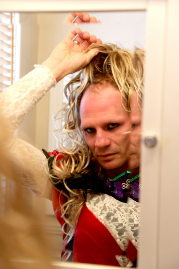 Dale Crites looks at himself as he makes the transformation from BritneyGirl back to Dale. (Kaitlin Newman/Baltimore Sun)