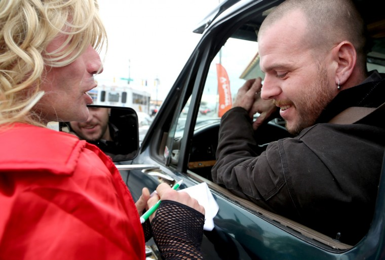 Roy Johnson, right, of Severn says BritneyGirl puts a smile on his face when he drives down the road. Here, Crites is giving Johnson the new Facebook account, since the previous one has reached a maximum friend capacity. (Kaitlin Newman/Baltimore Sun)
