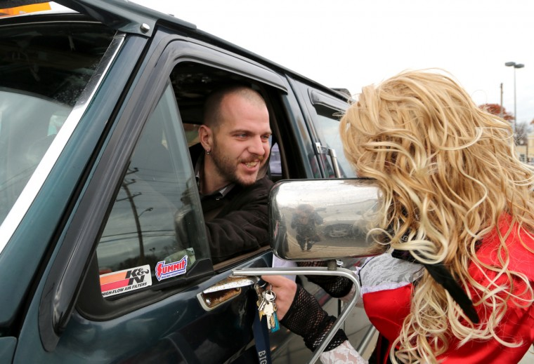 Roy Johnson of Severn stops to chat with BritneyGirl. He says seeing Dale puts a smile on his face when he drives down the road. (Kaitlin Newman/Baltimore Sun)