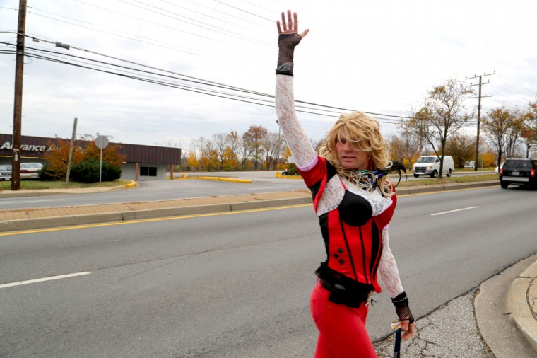 "As Dale Crites known as BritneyGirl Dale walks along Ritchie Highway many cars honk in recognition and people scream out ""I love you BritneyGirl!"" (Kaitlin Newman/Baltimore Sun)"