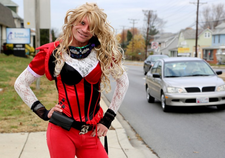 Dale Crites enjoys dressing as his alter ego BritneyGirl Dale and walking along Ritchie Highway most days. Crites stops and poses for people stopped at the red lights, usually involving them in the photos as well. (Kaitlin Newman/Baltimore Sun)