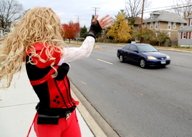 Dale Crites waves to drivers and other pedestrians on Ritchie Highway. Crites has been doing this since 2009 and has loved it ever since. (Kaitlin Newman/Baltimore Sun)