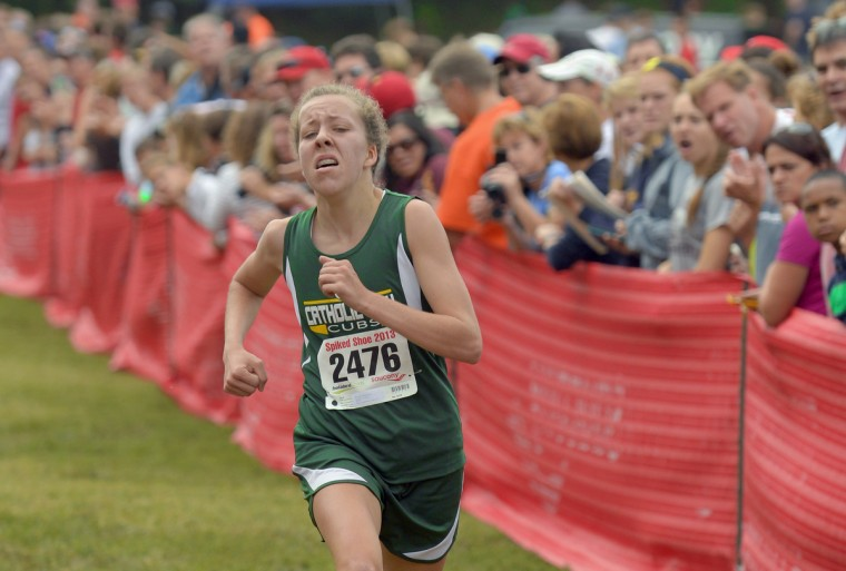 Catholic's Ellie Gonzalez sprints to the finish to win in the Girls' Elite division of the Spiked Shoe cross country Invitational at Wyman Park. (Doug Kapustin/For The Baltimore Sun)