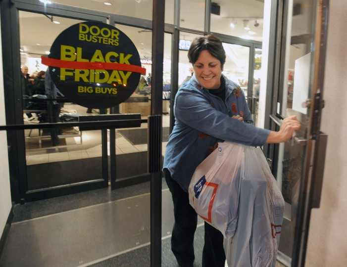 Betty Allen, of West Friendship, leaves the JC Penny with her purchases at the in the Mall in Columbia on Black Friday. She started her shopping spree at midnight. (Kenneth K. Lam/Baltimore Sun)