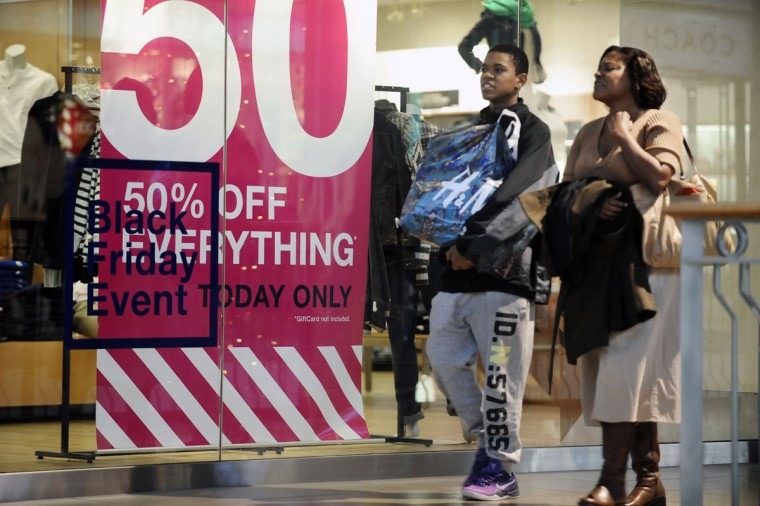 Jennifer Williams, of Catonsville, and her son David, 15, heads toward the Foot Locker store for the new Jordan 5 sneakers while shopping at the in the Mall in Columbia on Black Friday. (Kenneth K. Lam/Baltimore Sun)