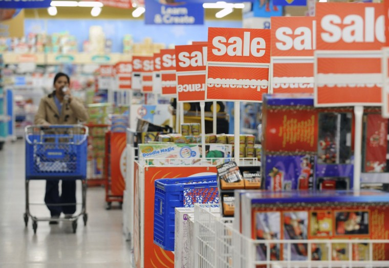 Shoppers like Anna Szuba, left, of Pasadena, looks for bargains at the Toys R Us store in Glen Burnie on Black Friday. (Kenneth K. Lam/Baltimore Sun)