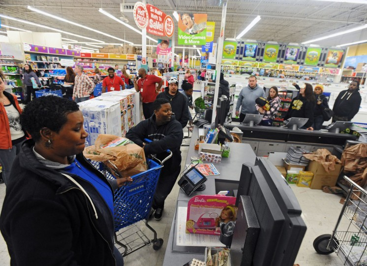 """Asia Turner, from left, of Baltimore, and friend """"Scooby"""" are the first in line for the 5 a.m. tablet computer door buster deal at the Toys R Us store in Glen Burnie on Black Friday. The two has started the line at midnight. (Kenneth K. Lam/Baltimore Sun)"""