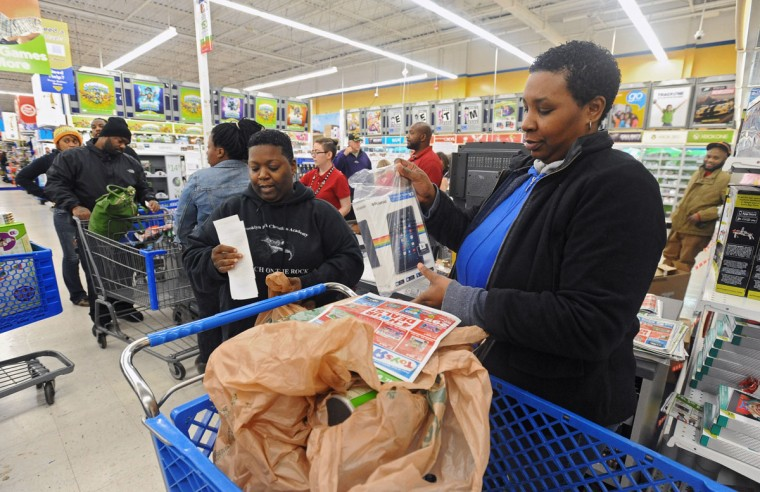 """Asia Turner, from right, of Baltimore, and friend """"Scooby"""" are the first to get the 5 a.m. tablet computer door buster deal at the Toys R Us store in Glen Burnie on Black Friday. The two has started the line at midnight. (Kenneth K. Lam/Baltimore Sun)"""