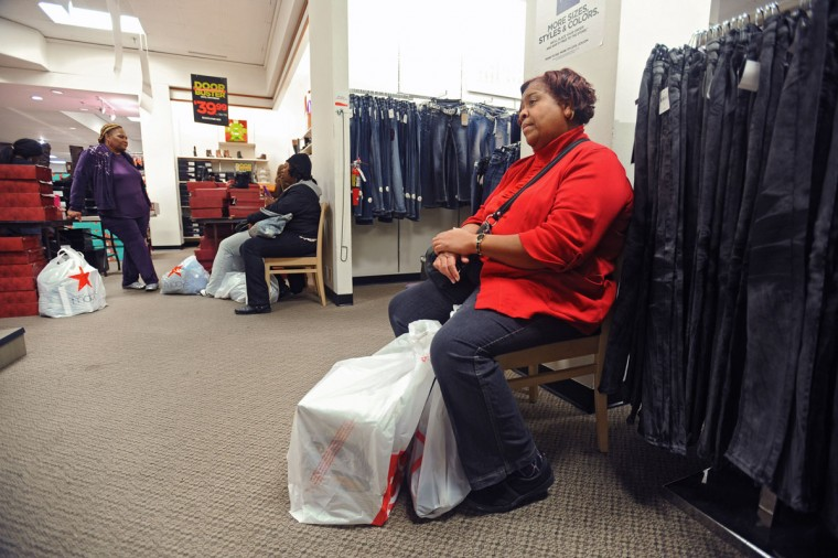 Gail Owens, right, of Baltimore, who describes herself as a shopaholic, rests her feet while shopping with her daughter, niece and a friend at the J C Penny in the Mall in Columbia on Black Friday. (Kenneth K. Lam/Baltimore Sun)