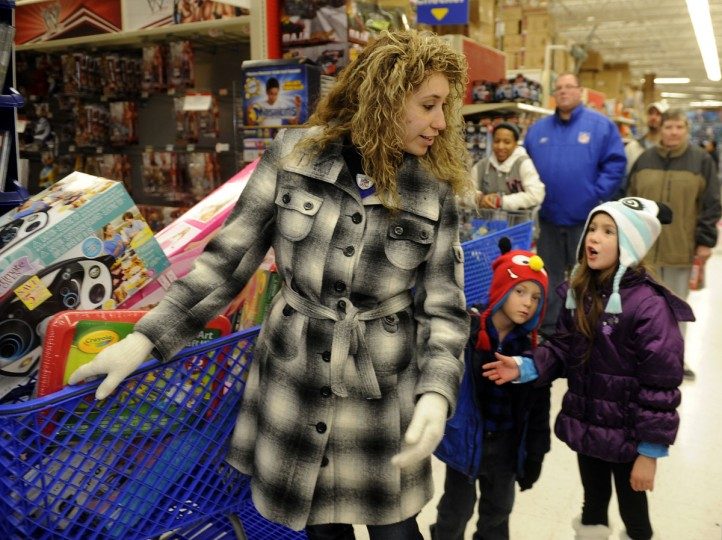 Nicole Cornejo shops in Toys R Us with her children, 5 year old Briana Lloyd, on right, and twin sons Joe and Cameron Lloyd. They and hundreds of other Thanksgiving shoppers waited in line for hours to shop at Toys R Us on Thanksgiving evening. (Barbara Haddock Taylor/Baltimore Sun)