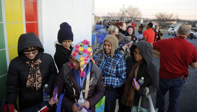 Members of the Parana and Abuan families were the first in line at Toys R Us. They and hundreds of other Thanksgiving shoppers waited in line for the chance to shop on Thanksgiving evening at Toys R Us. (Barbara Haddock Taylor/Baltimore Sun)