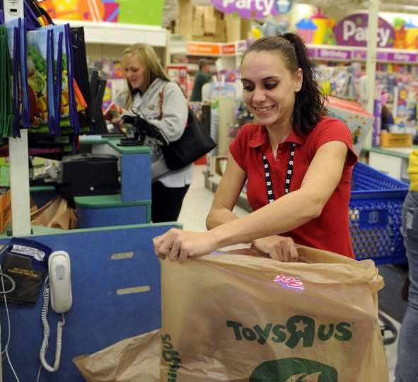 Shannon Sweitzer, a cashier at Toys R Us, puts a customer's toys in a package. (Barbara Haddock Taylor/Baltimore Sun)