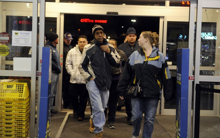 Thanksgiving shoppers walk into Best Buy after waiting several hours in line outside. (Barbara Haddock Taylor/Baltimore Sun)