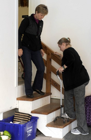 Erika Brannock climbs the stairs from her family's garage as her mother, Carol Downing, stands on left. (Barbara Haddock Taylor/Baltimore Sun)